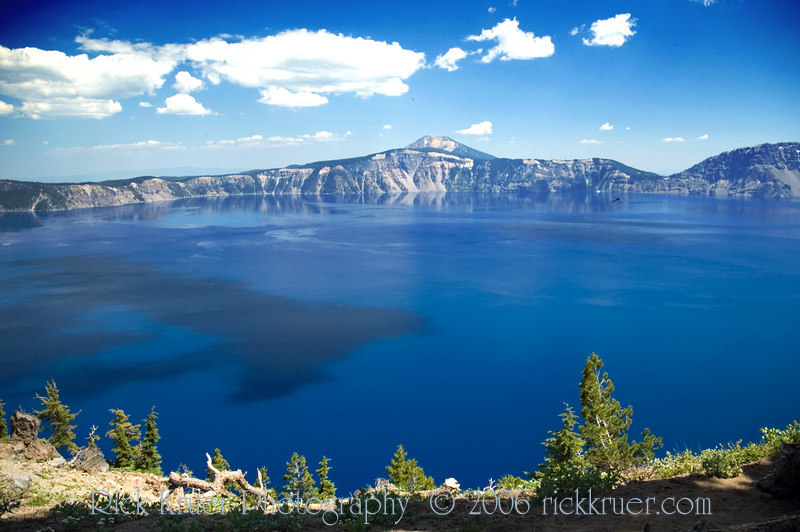 Crater Lake is a beautiful deep blue lake due to the fact that the only fill for the lake is the clean, clear snow and rainfall. The clouds form interesting, dark shadows on the surface of the lake. The location is at Merriam Point near the trail we found near the North Entrance of the Rim Drive, on the west end of the lake. Looking toward the Northeast in this photo.<br /> ND70_2006-07-26DSC_5979-DragonflyCraterLakeDeepBlueCloudShadows-nice-2 copy.jpg