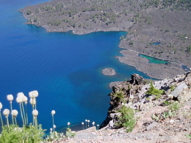 Eileen's photo, closeup of Wizard Island taken from the west side of Crater Lake, OR. Note the deep green pools of water around the island.<br /> P7250503-CraterLakeWizardIslandSteepCliffsMerriamPoint-2.jpg