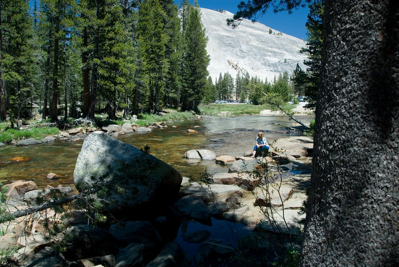 Landscape shot of Eileen relaxing and having her Zen moment watching, listening and absorbing all of the beauty of the Tuolumne River on the east side of Yosemite.<br /> <br /> D200_2007-07-02DSC_0692-EileenZenMomentTuolumneRiverWide-2.jpg