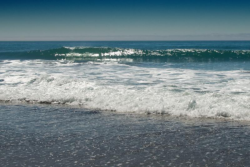 Sun sparkles on the waves at low tide at Gleneden Beach, Oregon<br /> July 2007<br /> <br /> Copyright © 2007 Rick Kruer<br /> rickkruer.com<br /> <br /> D200_2007-07-08DSC_1280-WaveCurlSunSparkle-2.psd