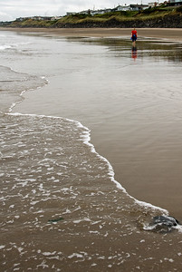 Eileen walks quietly along the beach during negative low tide. D200_2007-07-17DSC_2180-EileenWalkingSurfTall-3.jpg