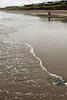 Eileen walks quietly along the beach during negative low tide.<br /> D200_2007-07-17DSC_2180-EileenWalkingSurfTall-3.jpg