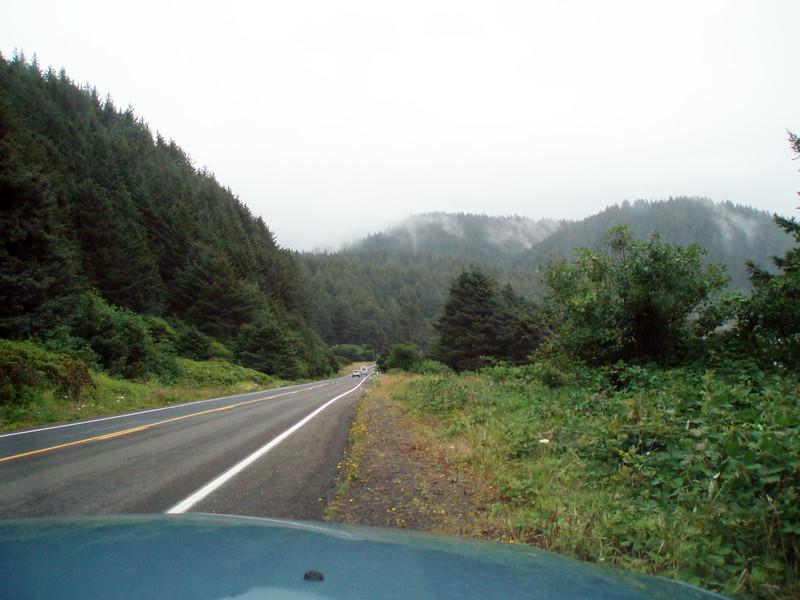 The fog is rolling in as we approach Heceta Head on the Oregon Coast.<br /> P7201706-FogRoadUS101HecetaHead-2.jpg