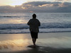 Rick in silhouette at sunset at the Cavalier beach.<br /> P7181600-RickSunset-2.jpg