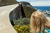 Eileen right along Bixby Bridge (1932) looking for the next great flower photo.<br /> D200_2007-07-25DSC_3250-EileenPhotosFlowersBixbyBridge-2 copy.jpg