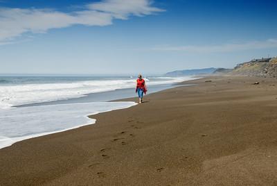 Eileen walking along the edge of the surf on a beautiful afternoon on the Oregon Coast. D200_2007-07-12DSC_1569-EileenWalkingSurf-2 copy.jpg