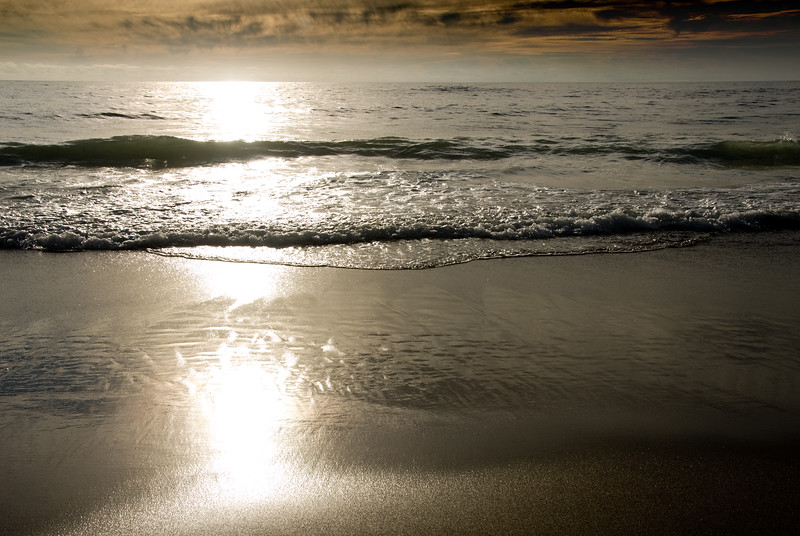 Sunset Reflecting in the Sand<br /> Gleneden Beach, Oregon<br /> July 2007<br /> <br /> Copyright © 2007 Rick Kruer<br /> rickkruer.com<br /> <br /> D200_2007-07-15DSC_1963-SurfLinesSunsetSandReflections-2.psd