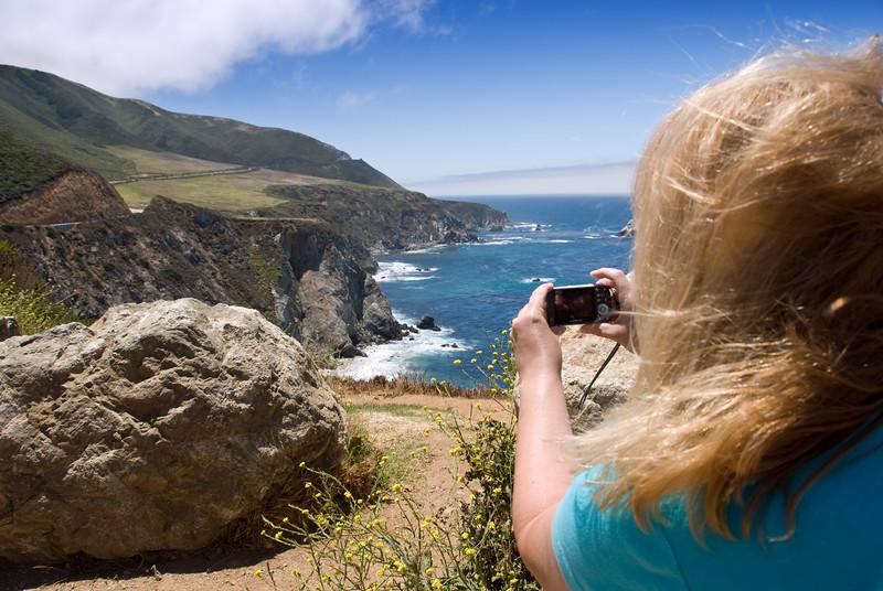 Eileen composing a landscape photo near Bixby Bridge, Big Sur, California.<br /> D200_2007-07-25DSC_3254-EileenPhotosRoadOceanViewBixbyBridge-nice-2 copy.jpg