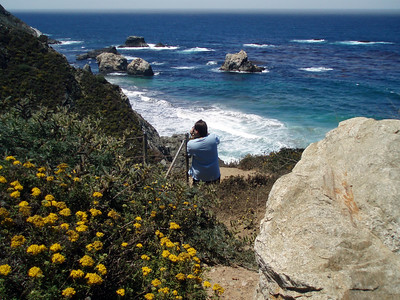 Eileen captures wildflowers, great scenery and Rick taking photos along the coast at Big Sur, CA near Rocky Creek Bridge. P7252021-RickPhotosRockyCreekBridge-2.jpg