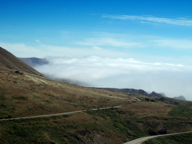 Eileen's nice photo of the fog rolling in off the coast of California covering the road along coast route CA 1.<br /> P7231932-RoadCA1Fog-2.jpg