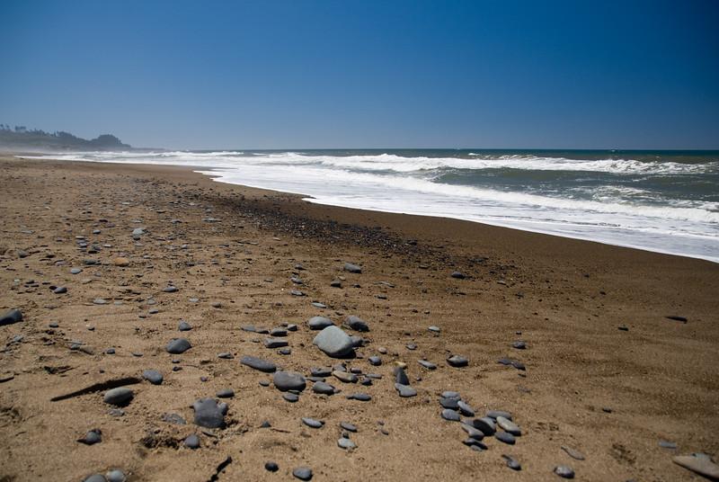 Rocky Beach and Red Tint Ocean, Cavalier Beach, Central Oregon Coast<br /> July 2008<br /> <br /> Copyright © 2008 Rick Kruer<br /> rickkruer.com<br /> <br /> D200_2008-07-12DSC_6512-RockyBeach-nice-2.psd