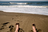 Relaxing on the beach on a calm Sunny day<br /> Central Oregon Coast<br /> Gleneden Beach, Oregon<br /> July 2008<br /> <br /> Copyright © 2008 Rick Kruer<br /> rickkruer.com<br /> <br /> D200_2008-07-16DSC_6939-RickFeetViewCalmOcean-nice-2.psd