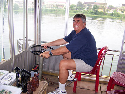 VBTours' guide Dave Macedonia steers our boat up the Perfume River in Hue.
