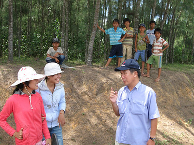 Mr Cong, a retired school teacher is one of the tour guides that we use while touring in the center part of Vietnam (I-Corps, II-Corps). Here he is talking to local children, they are excited to learn about us as this area doesn't get outside visitors.