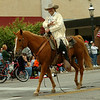Pawnee Bill, portrayed by Kevin Webb, acknowledges the crowd during the Cherokee Strip Parade Saturday. (Staff Photo by BONNIE VCULEK)