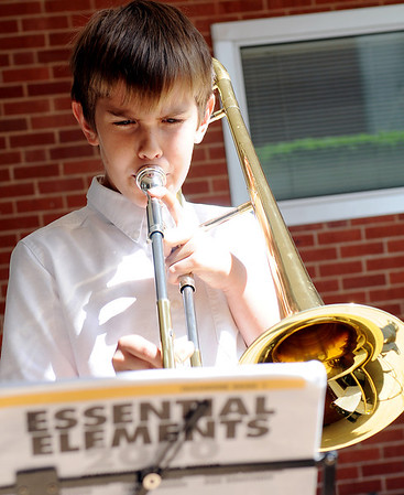 Jacob Martin, an 11-year-old 5th grade student at St. Eugene's Catholic Church in Oklahoma City, practices his Tri-State Music Festival piece outside Central Christian Church Wednesday. (Staff Photo by BONNIE VCULEK)