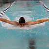 Enid's Charles Laws swims the butterfly leg of the 200 yard IM Monday at the Denny Price Family YMCA. (Staff Photo by BILLY HEFTON)