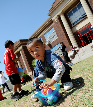 Kindergarten students at Garfield Elementary School fill their baskets with 20 Easter eggs during a mathematics lesson Friday. (Staff Photo by BONNIE VCULEK)