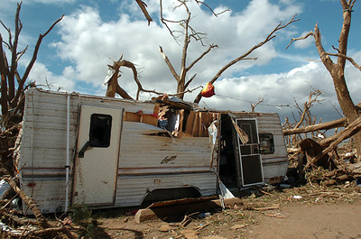 A destroyed travel trailer sits among trees striped of their limbs and leaves at Canadian Recreation Area on Canton Lake after a tornado make a direct hit on the campground Tuesday. (Staff Photo by BILLY HEFTON)
