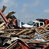Twisted metal and tossed trucks at a farm west of Medford Tuesday after a tornado moved across Grant County Monday evening. (Staff Photo by BILLY HEFTON)