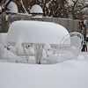 Snow covers a patio table Wednesday morning after a winter storm dropped an estimates foot of snow on the Enid area. (Staff Photo by BILLY HEFTON)