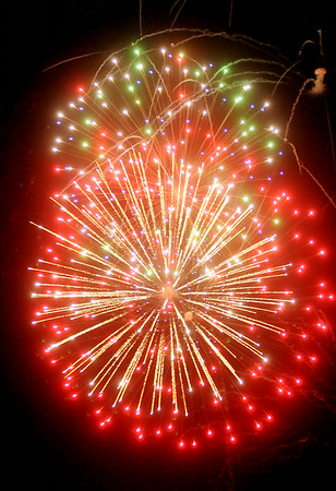 Fireworks illuminate the sky at Meadowlake Park during the annual Fourth of July fireworks extravaganza Friday, July 4, 2014. (Staff Photo by BONNIE VCULEK)