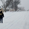 A New Orleans Saints fan walks along east Broadway Wednesday morning after a winter storm dropped an estimates foot of snow on the Enid area. (Staff Photo by BILLY HEFTON)