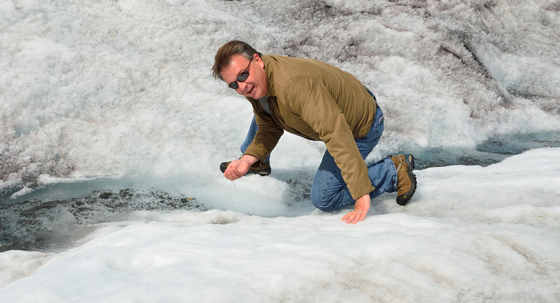 Stan drinking glacier water.