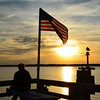 Stan and the seagull watching the sunset while the flag flies.  Harbour Town.