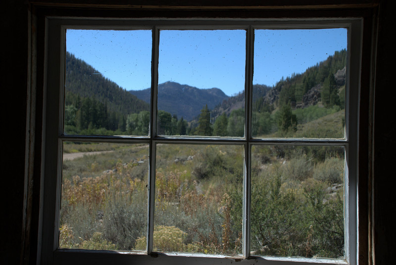 View through the window of shack at Abandoned gold mining town - Custer, Idaho