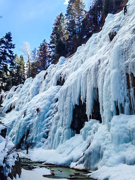 Climbers exploring the water ice at the Ouray Ice Park, CO. Cropped