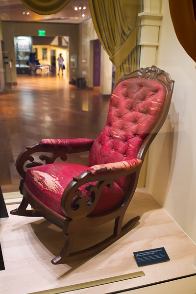 The actual chair in which President Lincoln was sitting when he was shot.