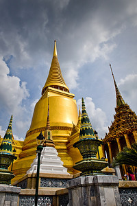 Grand Palace Bangkok In October 2008, it was HOT in Bangkok. And there were thunderstorms. Political unrest was rising and would eventually force a change in government only a month later. But in the mean time, the Grand Palace was stately and beautiful. There are a number of flaws in this photo but it remains one of my favorites.