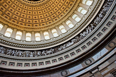US Capital Dome One of my favorite sites in Spring of 2008 in Washington DC was the Capital. It is a majestic building seen from the street, but in many ways, it's more interesting inside. The carved figures you can see inthe photo are not carved at all, but rather are painted on the flat surface of the dome.