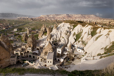 Cappadocia Landscape In our April 2008 Turkey trip, we spent several days in Cappadocia marveling at the way houses, shops, hotels, churches and such were carved out of the Tufa hillsides. As the region's population has grown, the buildings have been extended in conventional ways leading to remarkably picturesque villages such as this one.