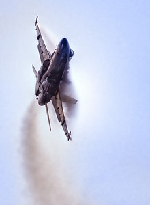 I love it when I can catch the vapor over the wings and body of the jets! In a steep bank, the air pressure above the wings is very low and moisture in the air condenses out to produce the vapor.
