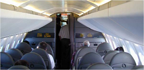 Cabin: The cabin is similar to an MD-80 with 26 rows of 4 seats and an isle down the middle. At the front is a display with continuously updates speed (mach and miles per hour), altitude, and outside air temperature.