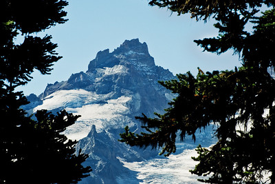 On the shoulder of Mt Rainier is Little Tahoma. My daughter has climbed it and tells of a treacherous climb with lots of broken and falling rock. Helmets are the order of the day, for sure. Mt Rainier gets all the press, and it's well deserved, but I like this little peak, too.