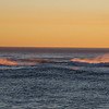 The sunset catches the mist off of waves,<br /> Depoe Bay, Oregon