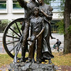 The Promised Land, (1993) by Oregon artist David Manuel, is a bronze statue commemorating the 150th anniversary of the Oregon Trail in 1993.<br /> Chapman Square, Portland, Oregon