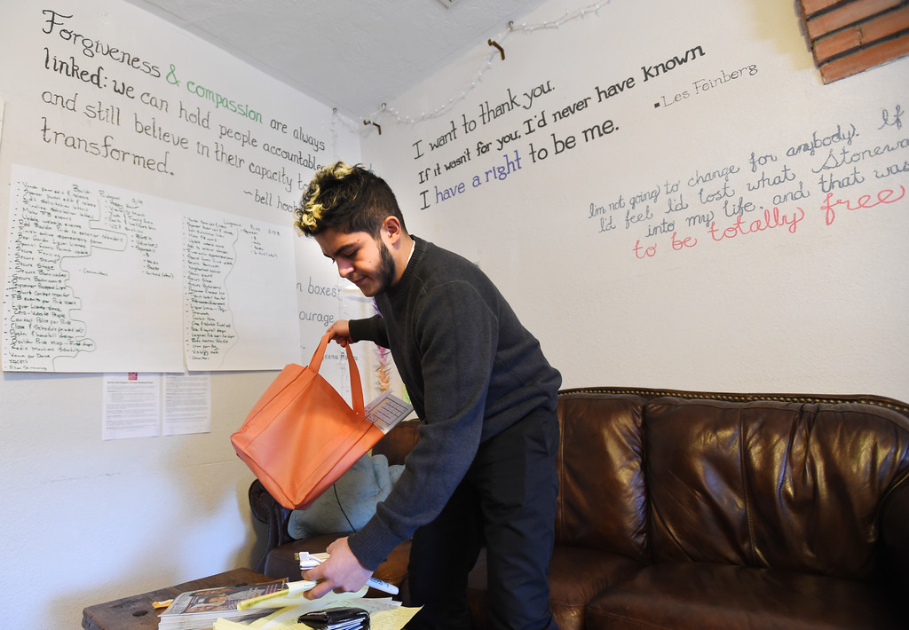 . Juan Moreno, Development and Special Events Coordinator, organizes their work at Out Boulder County in Boulder on Tuesday.  Cliff Grassmick  Photographer January 16, 2018