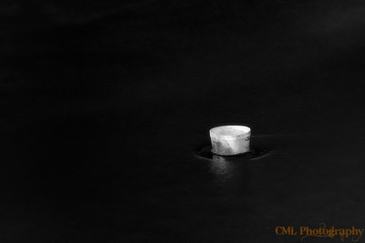 In the middle of the ice was an old styrofoam night crawlers cup.  The cup is just warm enough to create a small hole in the ice.