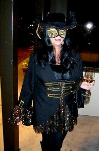 It's gonna be a long night when you see a Renaissance femme fatale out front, wearing a mask and carrying a drink...