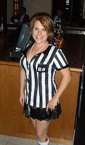 Now THIS is a referee!  Mandy gave up refereeing football games and soccer matches.  The teams quit playing long enough to watch her run downfield.
