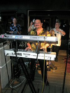 Lucky 7's Doug Bitting on the keyboard.  He's the guy you talk to if you want to book Lucky 7.  You should book 'em soon.  They rocked the joint!