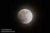 The moon just starting its eclipse through thin clouds (4/15/2014)<br /> EF400mm f/5.6L USM +2x III @ 800mm f11 1/100s ISO400