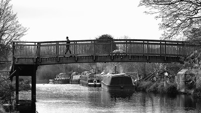 Man and Dog Crossing the Kennet and Avon Canal Newbury via Bridge 63 at the site of the old Monkey Bridge