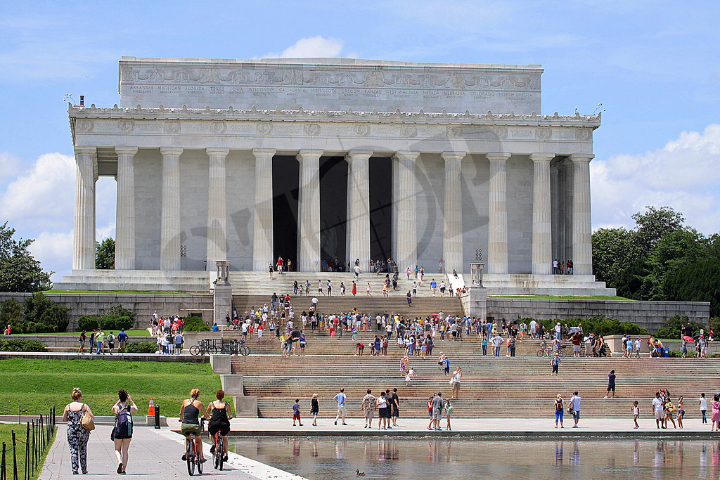 The Lincoln Memorial stands at the west end of the National Mall as a neoclassical monument to the 16th President. The memorial, designed by Henry Bacon, after ancient Greek temples, stands 190 feet long, 119 feet wide, and almost 100 feet high. It is surrounded by a peristyle of 36 fluted Doric columns, one for each of the thirty six states in the Union at the time of Lincoln's death,