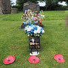 A very colourful graveyard with tributes to local people.