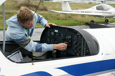 My roomie the pilot, Mike, doing the preflight check.